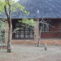 Thatched wooden house in Leeupoort Game Reserve