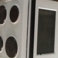 Kelvinator oven and 4 plate stove with warmer draw
