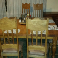 Solid oak table with eight chairs