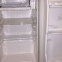 In mint condition, Like New Glossy White Samsung Bar Fridge with a freezer & trays included in sale