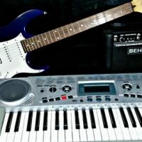 Ibanez gio electrical guitar, strap, original guitar case, a BEHRINGER amplifier, MEDELI  keyboard.