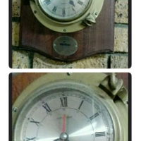 Brass porthole wall clock.