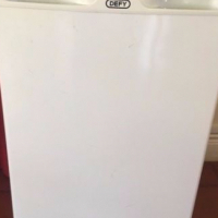 In mint condition, Like New Glossy White Defy Bar Fridge with a freezer & trays included in sale...