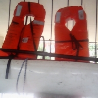Canoe with oars and lifesaver
