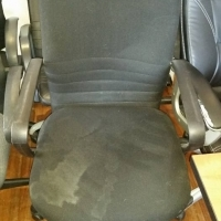Executive office chair with stains