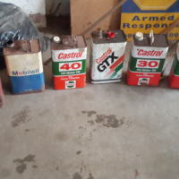 vintage oil and petrol cans