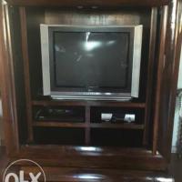For urgent sale.Large Coricraft dark wood sliding door TV cabinet for sale. Valued at R9000