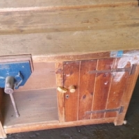 Old school woodworking bench with two vices