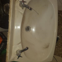 Ceramic hand wash basin with taps