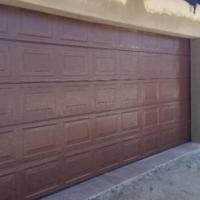 Garage Door Special Finger proof Double Sectional Steel Garage Door. Brand New. With all hardware in