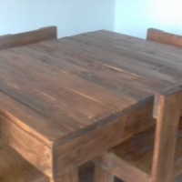 wooden table with four chairs