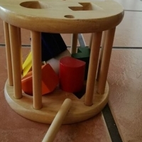 Wooden toy with six shapes and holes