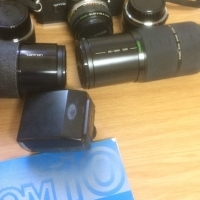OLYMPUS OM 10 CAMERA AND LENSES