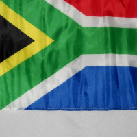 South African flag on a pole with a car window clip