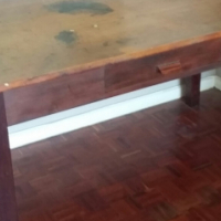 Wooden table with single drawer
