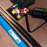 3 snooker cues and balls