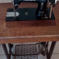 HUSQVARNA SEWING MACHINE IN CABINET.