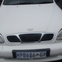 Daewoo Lanos 1.4is 4 Doors, Factory A/C and C/D Player, Central Locking, White