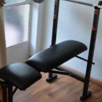 Trojan work out bench, 45kg weights, weight bars, and stationary bicycle