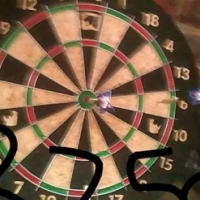 Dart board with darts.