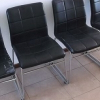 Set of 4 black metal chairs in fair condition.