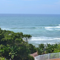 DIRECT BEACH ACCESS - STYLISH FURNISHED APARTMENT FOR SALE LOWER SOUTH COAST KZN .