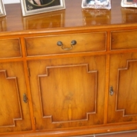 English sideboard in Yew wood. 3 drawers 3 cupboards.