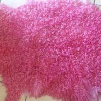 genuine curly sheepskin rug.