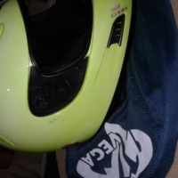 kawasaki leather jacket and two helmets for sale