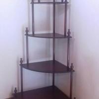 Dark wood corner shelving unit