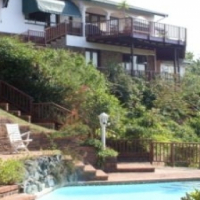 FOUR BEDROOM HOUSE PLUS FLAT ON THE WATERS EDGE STUNNING VIEWS R1,750,000 NEGOTIABLE – UMTENTWENI
