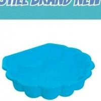Plastic seashell sandpit