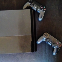 Playstation 4 with two joysticks and Fifa 15 and driveclub