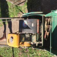 Large petrol lawn mower. - self driven with a roller blade and roller.  Hardly used
