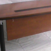 Cherry wood bow front straight desk