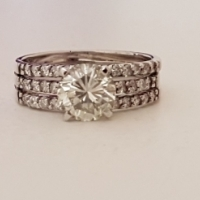 18ct White Gold Solitaire Halo Ring