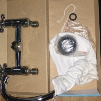 Doble swing tap for twin basin