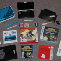 Nintendo 3DS console with 2 pokemon games