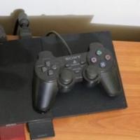 Playstation 2 te koop met een remote