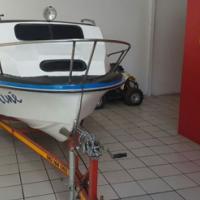 Cabin cruiser boat for sale.