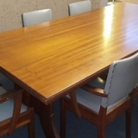 Boardroom table with 7 grey leather chairs