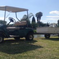 Ez-Go Petrol golf cart with trailer for a farm