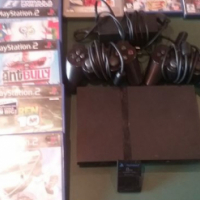 Playstation 2 with 2 remotes and memory card