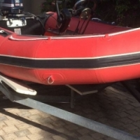 Trailer for Zodiac inflatable and 30HP Evinrude Outboard Motor