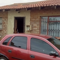 A nice and neat 4 rooms house in orange Farm is for grab  Hurry.