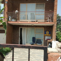 Windsor East off Republic Road large duplex corner stand consisting of 3bedroomed upstairs, balcony