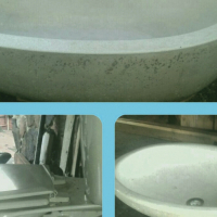 Natural stone bath and basin, with ceramic toilet,