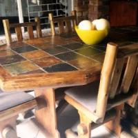 Solid Saligna Log Diningroom Table.