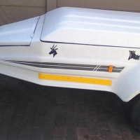Kupa fibreglass trailer with mag wheels.