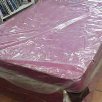 New Double bed in plastic.